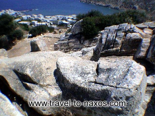 APOLLONAS KOUROS - The Kouros at Apollonas with the village in the background.