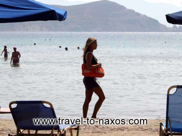 GIRL ON THE BEACH - A beautiful girl walking on Agios Georgios beach