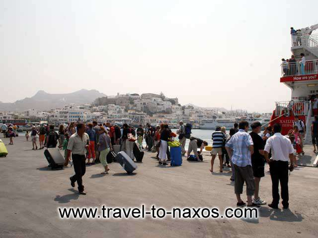 NAXOS PORT - Tourists arriving in Naxos and the castle in the background