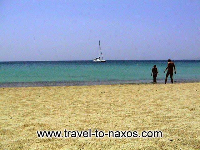 One of the island's big trump cards are the huge sandy beaches <BR>which follow on one after the other along the hole length of the SW coast <BR>and are some of the most beautiful beachesin the hole Mediterranean. NAXOS PHOTO GALLERY - AGIOS PROKOPIOS & AGIA ANNA BEACH